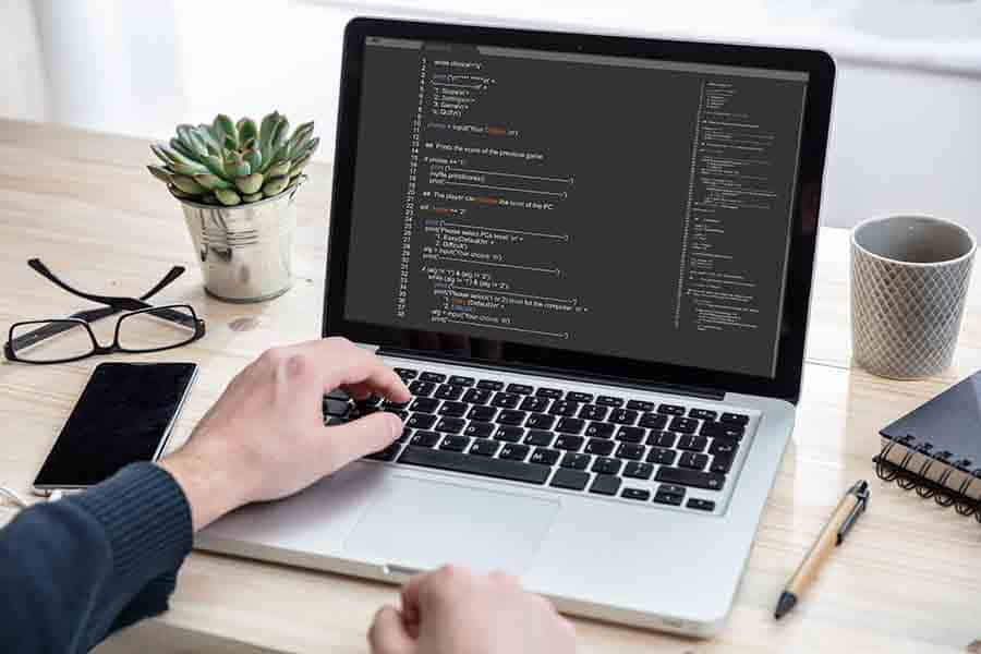programmer coding website functions on laptop