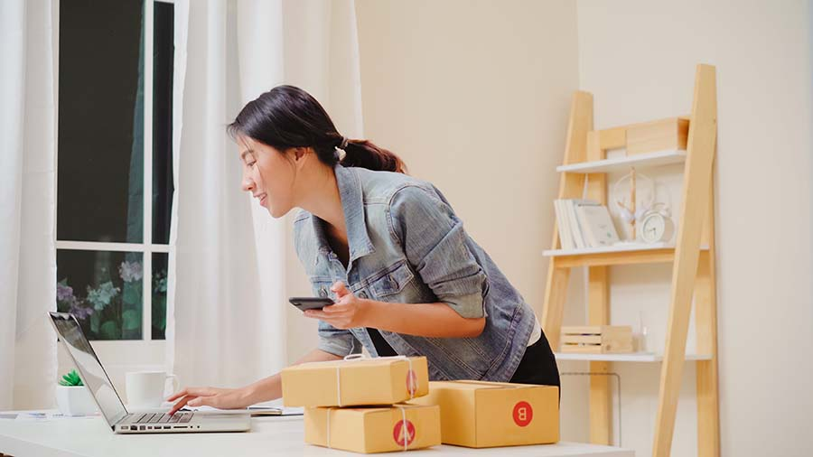 business owner managing her ecommerce inventory stock