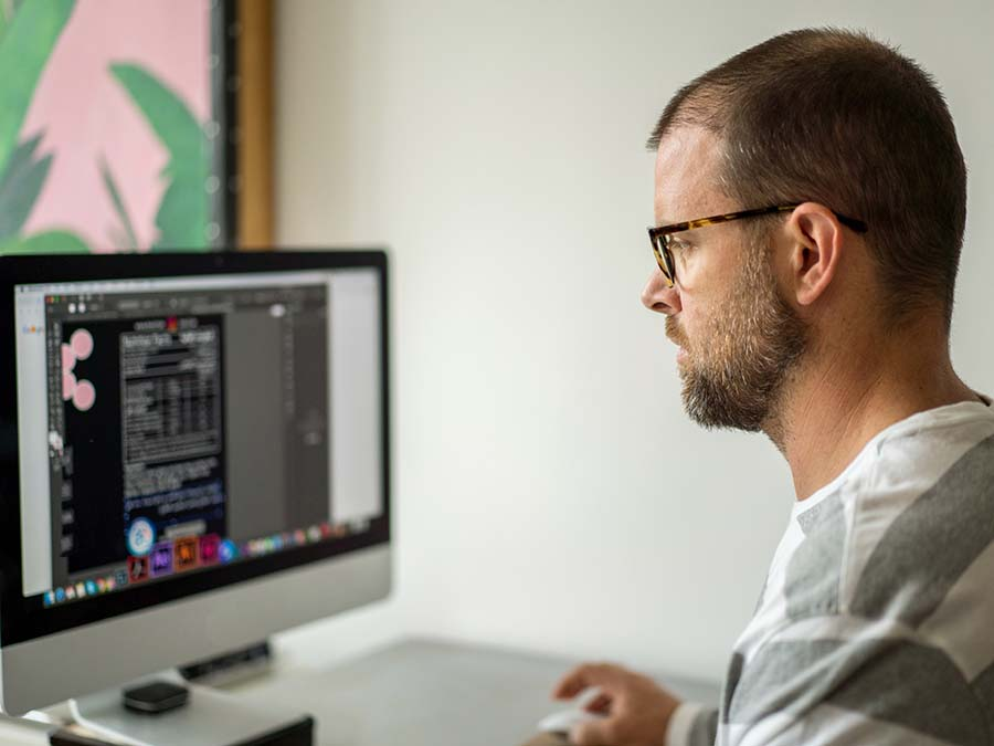 man concentrating on not making web design mistakes