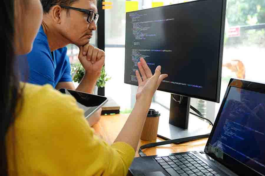 web development agency analyzing website code